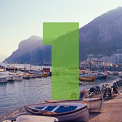 the number 1 superimposed over a picture of the harbor of the Isle of Capri, off the coast of Italy