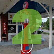 the number 2 superimposed over picture of gas pumps at old gas station in Florala, Alabama