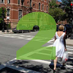 the number 2 superimposed over a picture of a woman carrying groceries home in two bags in the Boston's Back Bay