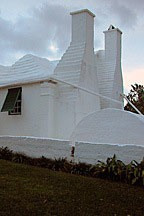 white stucco chimneys and cistern at the end of a house in Bermuda