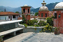 roof gardens in Antigua Guatemala are mostly paved, with plant beds & lanterns around the edges