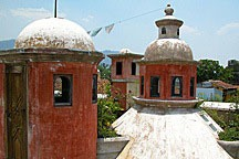 Antigua Guatemala rooftops include fanciful lanterns and vents