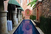 lap pool beside cafe seating in Antigua Guatemala courtyard