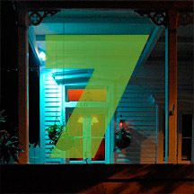the number 7 superimposed over night shot of front porch in Key West