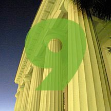 the number 9 superimposed over picture of the portico of a classical building in Charleston, South Carolina