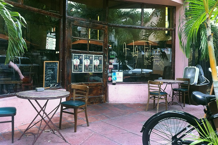 A la Folie, one of the coolest places to eat in South Beach, sits quietly among the palm fronds near the end of Espanola Way