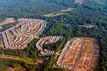 aerial view of suburban subdivision outside Atlanta with another subdivision under construction nearby