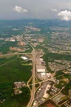 aerial view of expressway outside Raleight, North Carolina with surrounding sprawl