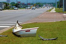 car wreckage lying by the side of arterial (Universtiy Drive) in Huntsville, Alabama
