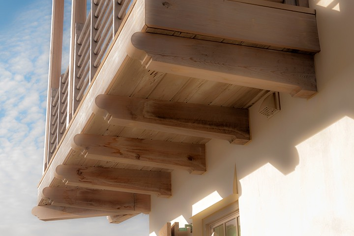 naturally finished scrolled wood cantilevered brackets support Alys Beach balcony