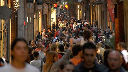 vibrant street scene on narrow pedestrian commercial street in Barcelona