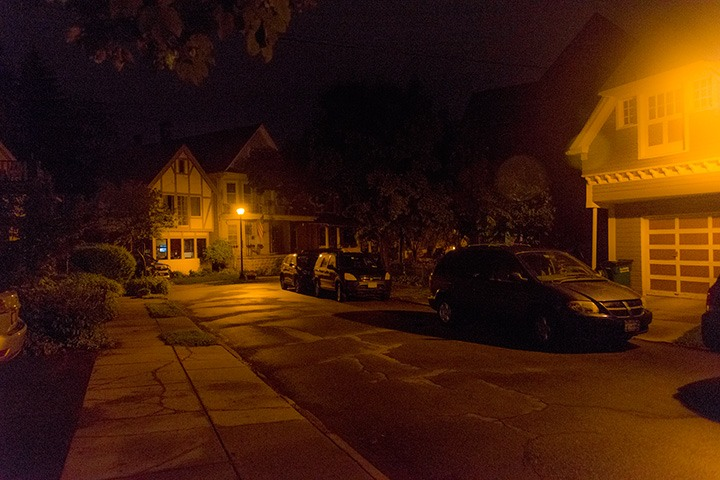 carriage house dissolves into the warm glow of the street light at the right edge of this scene, while two neighboring houses stand watch at the end of the street late on a Buffalo evening