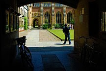 view through an archway into a courtyard at Cambridge University in England