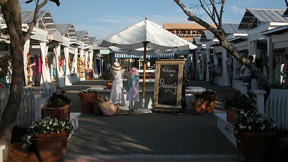 charming Perspicasity bazaar in Seaside, Florida is built of simple plywood boxes with front flaps that close at night