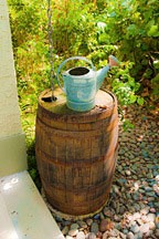 Kentucky Bourbon wooden rain barrel and watering can at the Chael-Dover Cottage in Miami, Florida