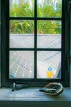photovoltaic panels hidden within roof of the Chael-Dover Cottage in Miami, Florida