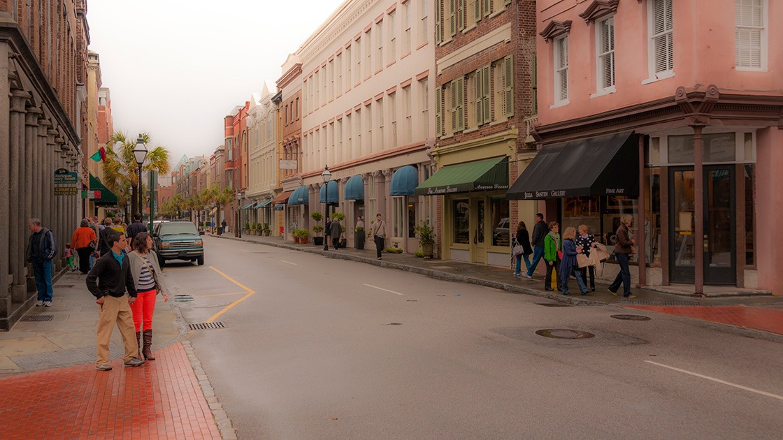 people flocking to King Street in Charleston after an early spring rain that still dampens the brick paving