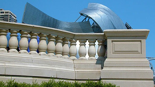 Frank Gehry bandshell behind classical balustrade at Millennium Park in Chicago