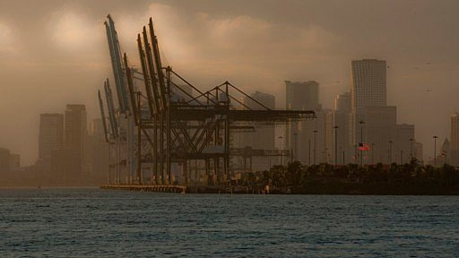cranes at Port of Miami, photographed from across the water of Biscayne Bay