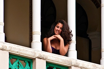 beautiful woman on balcony in Cienfuegos, Cuba