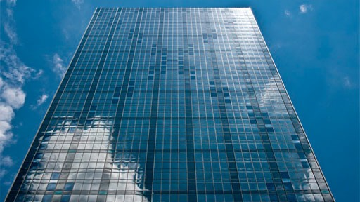 Dallas skyscraper with diagonal spandrel glass panel pattern covering structural bracing