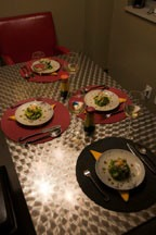 four dinner plates sitting on stainless steel table