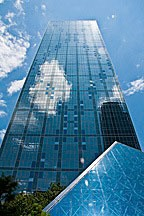 Dallas skyscraper with pyramidal glass roof in foreground