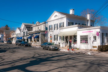 white shop fronts in Essex, Connecticut glow on a crisp winter noontime
