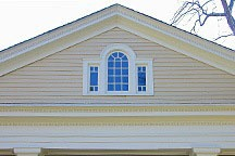 Palladian window in gable of mansion on High Street in Mooresville, Alabama