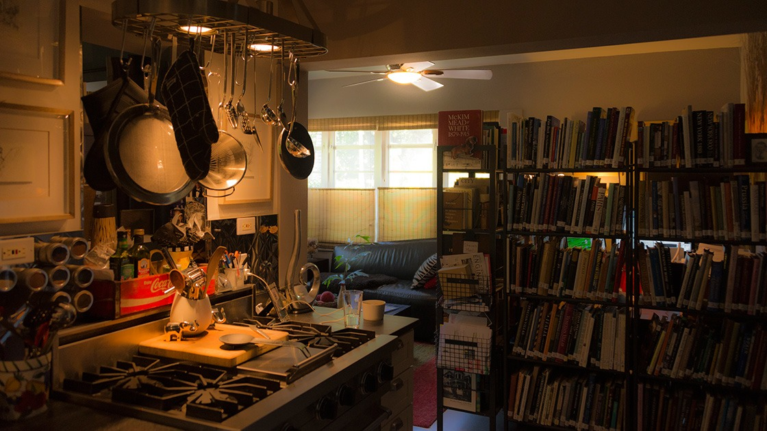 my office sits in 50 square feet, just behind a wall built of bookshelves, and tucked into a corner between living room and kitchen