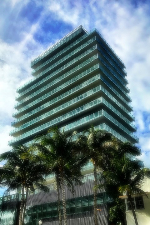 CorbMiesian mid-rise tower south of 5th street on South Beach is composed of steel and glass.