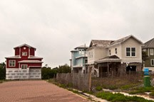 unfinished houses left open to weather in failed subdivision in Inlet Beach, Florida