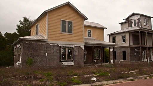 deteriorating houses in failed subdivision in Inlet Beach, Florida