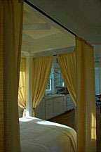 curtained bed alcove of Katrina Cottage VII