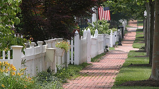 sidewalk bordered by picket fences in the Kentlands, near Gaithersburg, Maryland