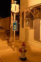night shot of Mile Marker 0 at the end of US 1 in Key West, Florida