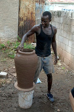 Rose Town potter working on a large pot