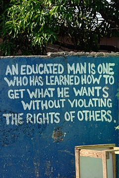 proverb painted on a wall in Rose Town, Kingston, Jamaica