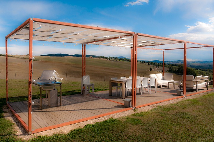 minimalist orange garden pavilion sits in the afternoon Tuscan light of La Bandita in Italy