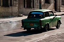 ancient car spewing oily exhaust on the streets of Havana