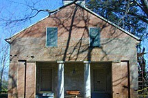 front of brick church in Mooresville, Alabama, with one door for women and another for men