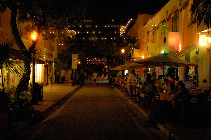 Española Way on South Beach all aglow with lights strung overhead from building to building as dinner patrons enjoy their meals