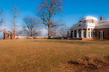 garden view of Monticello in morning light, showing small cottage and main house