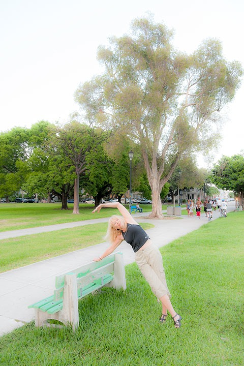 Nancy Bruning stretching on a park bench in South Beach's Flamingo Park