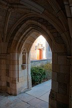 view through an archway to a door beyond at Yale University