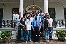 2009 Craft Apprentices posing for portrait on steps of historic house in Treme neighborhood of New Orleans