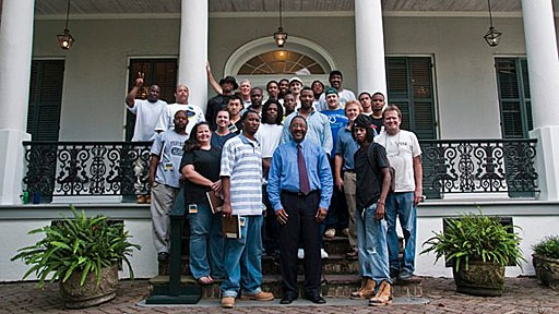 portrait of 2009 Prince's Foundation New Orleans craft apprentices on steps of historic house