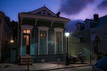 French Quarter shotgun cottage at nightfall