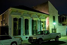 double shotgun cottage in New Orleans French Quarter at night
