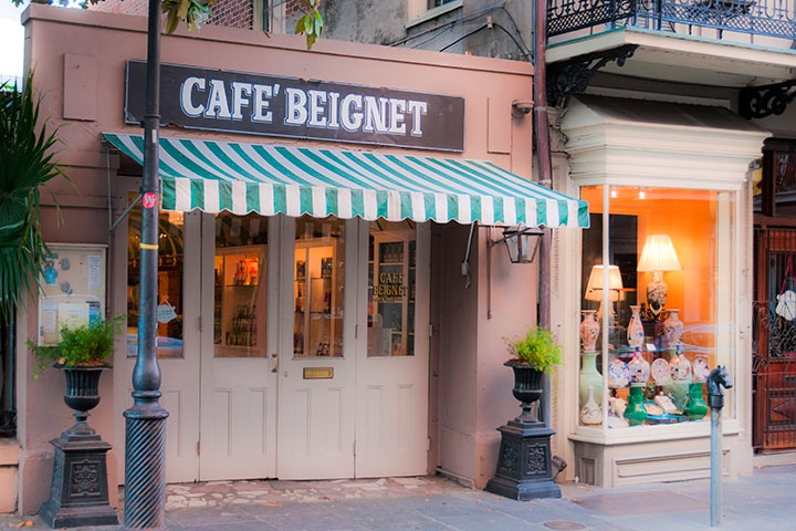 Cafe Beignet's tiny storefront embeds lots of charm under its blue-and-green striped awning on the French Quarter's Royal Avenue